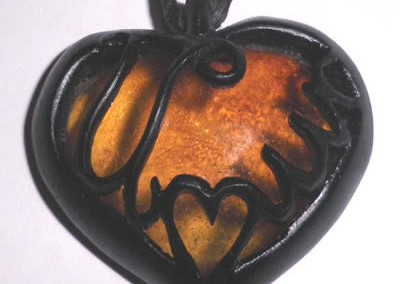 pendant in rescued ebony and Baltic amber