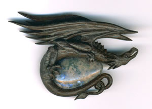 dragon brooch in bog oak and opal