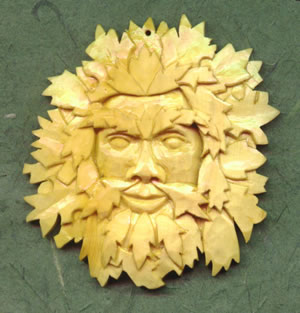 green man pendant in box wood